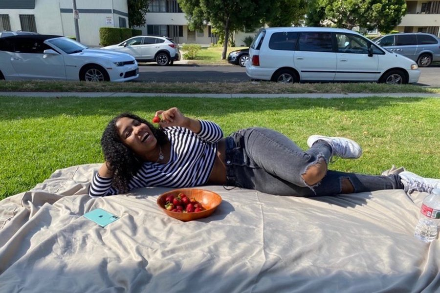 Junior Nyah Fernandez enjoys the gorgeous weather and strawberries. Being outside is a great for a change of scenery and to soak up the vitamin D that the sun provides.