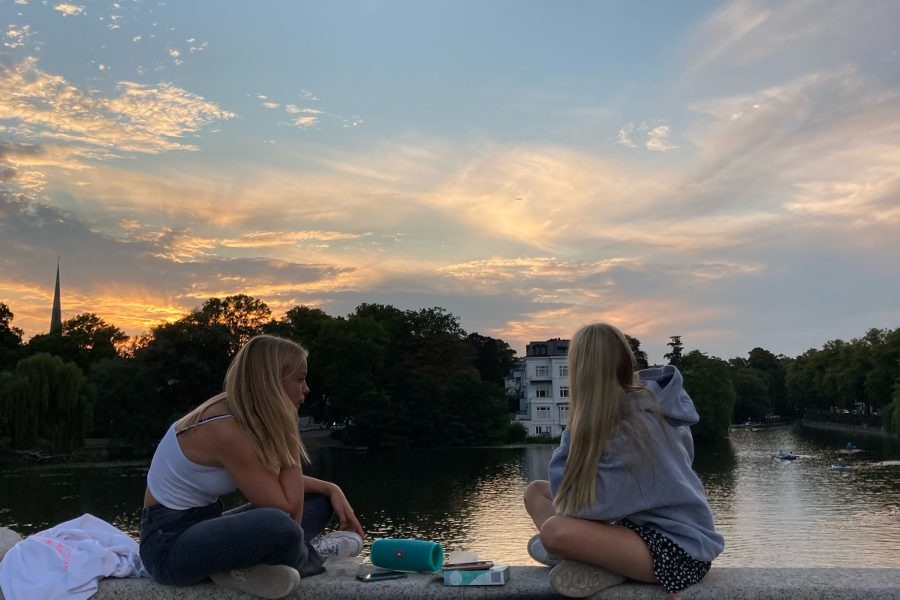 Letizia Oetker and her friend, Smylla, watch the sunset on a summer night at a nearby bridge after a bike ride. Bike riding is a common form of transportation for teenagers like Oetker.