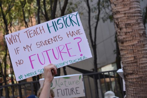 """This image is from the 2019 climate strike. """"I think when it comes to being a young climate activist, there is so much bad news we have to grapple with daily,"""" Archer junior Paola Hoffman said. """"What I remember about that strike was the overwhelming sense of hope at seeing so many other people who were right there with me. It really rejuvenates your will to keep fighting."""""""