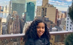 Sixth-grader Penny Franklin poses for a photo overlooking the Manhattan skyline in New  York City. Franklin said she would describe herself as a