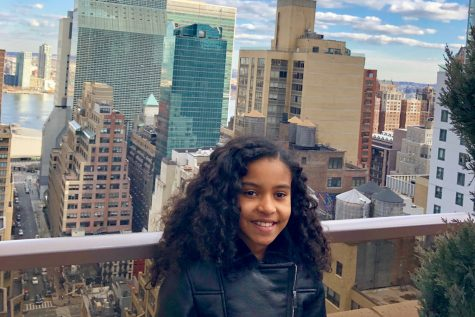 "Sixth-grader Penny Franklin poses for a photo overlooking the Manhattan skyline in New  York City. Franklin said she would describe herself as a ""city person"" at heart."