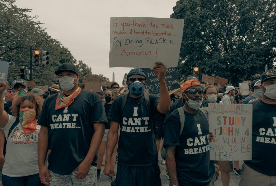On June 6, 2020, men stand in unity at the Black Lives Matter protest in Washington, D.C.