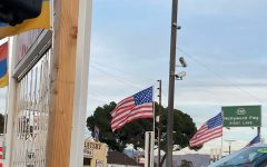 An American flag waves over a car dealership in Los Angeles, California. Amid the insurrection, the American flag was one of the many examples of paraphernalia displayed at the storming of the Capitol. Pro-Trump supporters held up and waived this flag during the