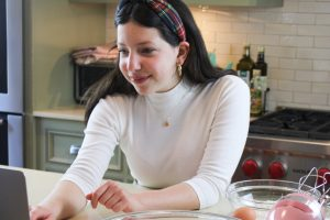 Ivy Woolenberg '25 works on an order for her business. Woolenberg started her baking business prior to COVID-19 however, she has been able to grow her business even more over the past couple months.
