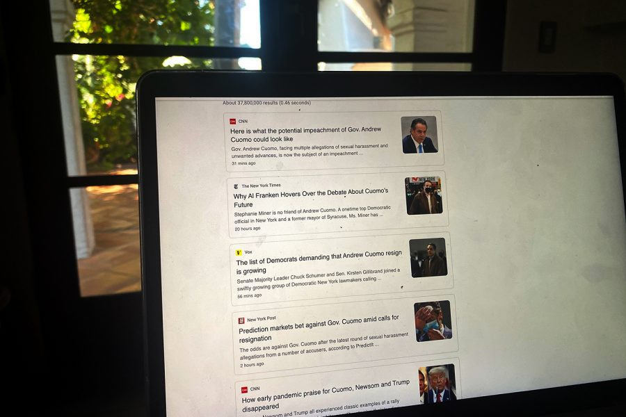 A computer screen lights up with news articles surrounding New York Governor Andrew Cuomo's sexual misconduct allegations. Cuomo currently has seven accusers.