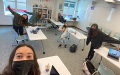Sophomore students take a socially distanced selfie with English teacher Stephanie Nicolard in her classroom. Students were welcomed back on campus to reconnect for social and emotional learning, as well as to continue their remote classes.