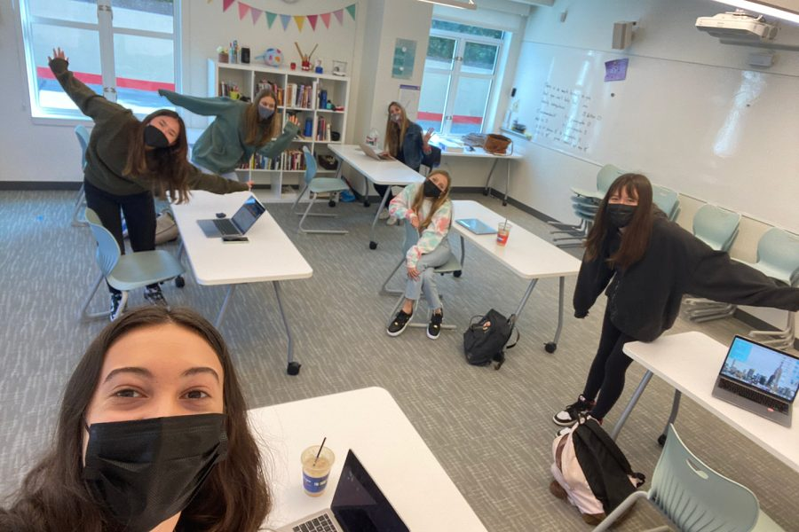 Sophomore+students+take+a+socially+distanced+selfie+with+English+teacher+Stephanie+Nicolard+in+her+classroom.+Students+were+welcomed+back+on+campus+to+reconnect+for+social+and+emotional+learning%2C+as+well+as+to+continue+their+remote+classes.