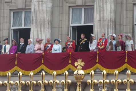 The British royal family stands on the balcony of Buckingham Palace in 2014. The Windsors have undergone a difficult year, in many ways characteristic of the social changes around them.