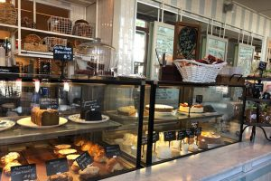 The counter at Bianca displays the day's pastries, ranging from banana bread to olive oil cake by the slice. Located at Platform LA, Bianca serves as both a bakery and restaurant for the Culver City area.