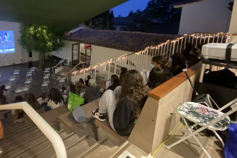 "Juniors sit in socially distanced seats in the amphitheater during the Junior Prom Movie Night. In place of the typical junior-senior prom, Archer hosted a movie night where the 2012 movie ""Pitch Perfect"" was projected for students."