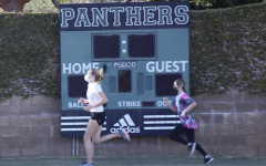Athletes Lauren Robson ('22) and Kate Hanney ('25) run on the Archer field during an Archer cross country practice. COVID-19 regulations have changed in L.A. county, allowing for Archer athletics to return to sports practices and some competitions.