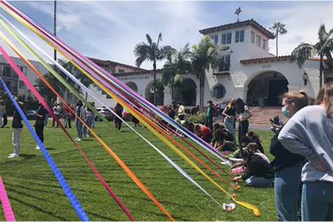 "Seniors gather on the front field of Archer to put up the annual Maypole. Senior Rio Hundley described the event as ""refreshing."" ""We finally got to participate in a tradition and really bond as a class in person,"" Hundley said."
