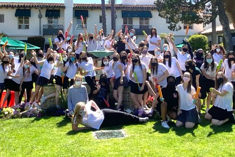 """The Class of 2021 poses in front of the fountain in the Eastern Star courtyard after squirting one another with water for the adapted tradition, the fountain jump, on their last day of classes. After getting drenched in water, senior Ava Salomon described the event as """"the best kind of hectic."""""""