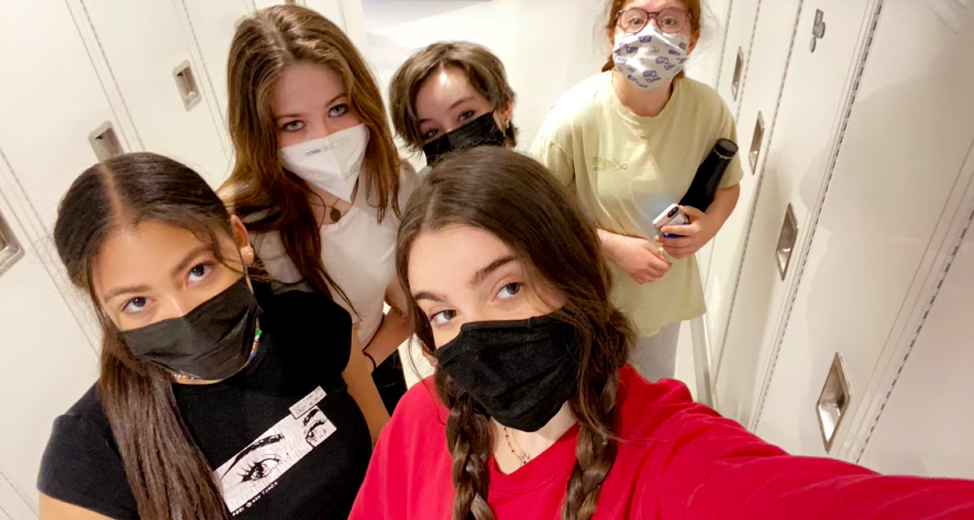 In this photo, Lola Lamberg ('21) takes a selfie with her friends in the hallway during her last week, as they prepare to graduate on Friday.
