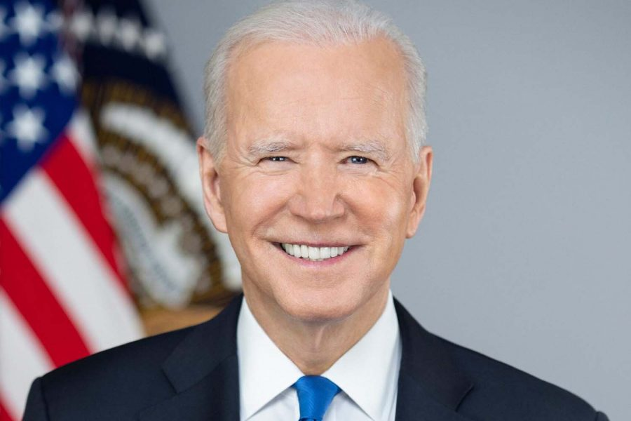 Joe Biden smiles for his official White House Portrait. The Biden administration has been in office for more than 100 days.