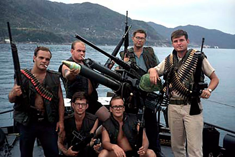 Lieutenant Donald Glenn Droz (right) poses with his crew on board his Navy ship in Vietnam. Droz was killed in battle on Apr 12, 1969, at 25 years old, leaving behind a wife, Judith Droz Keyes, and three-month-old daughter, Tracy Droz Tragos, whom he only met once.