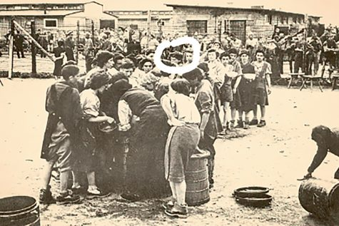 Liberation Day May 5, 1945: my great grandma (woman with white circle around her face) and other prisoners were given new boots and clothes after being freed from Mauthausen by the Americans. My great-grandma later moved to the United States, settling in Brooklyn, New York.