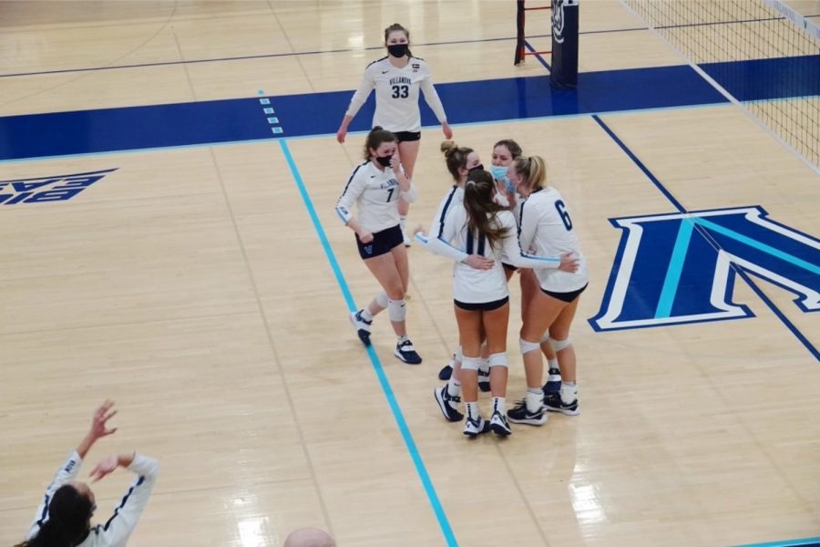 College freshman Andrea Campos and her teammates come together in a huddle during a volleyball game. During first semester we didnt have a single practice altogether, Campos said. That was difficult for us, but I think our team did a good job of trying to arrange socially distanced activities outside to get to know each other. Campos is a setter on the Villanova volleyball team.