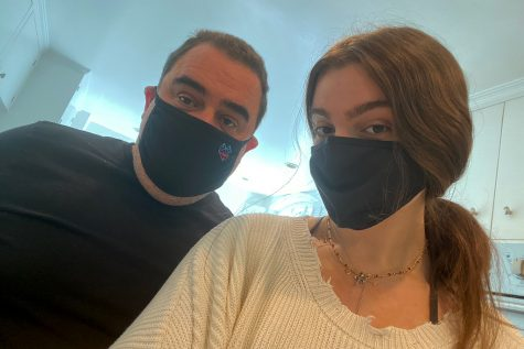 Senior Lola Lamberg and her father, Evan Lamberg, wear masks inside to maintain caution and mindfulness surrounding Covid. Even though it may be tempting to no longer follow Covid guidelines, we need to uphold the values of empathy and care in regards to our own health and the health of others, specifically in public spaces.