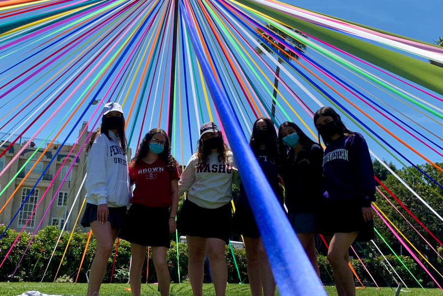 Seniors Sydney Raucher, Kaitlyn Kim, Maggie O'Leary, Eva Dembo, Jessica Tuchin, and Nicole Farmer celebrate their college decisions on the front lawn Friday, April 30. Seniors dressed up in their college gear today for an on-campus celebration in commemoration of May 1 knows as a national Decision Day in respect to the college process.