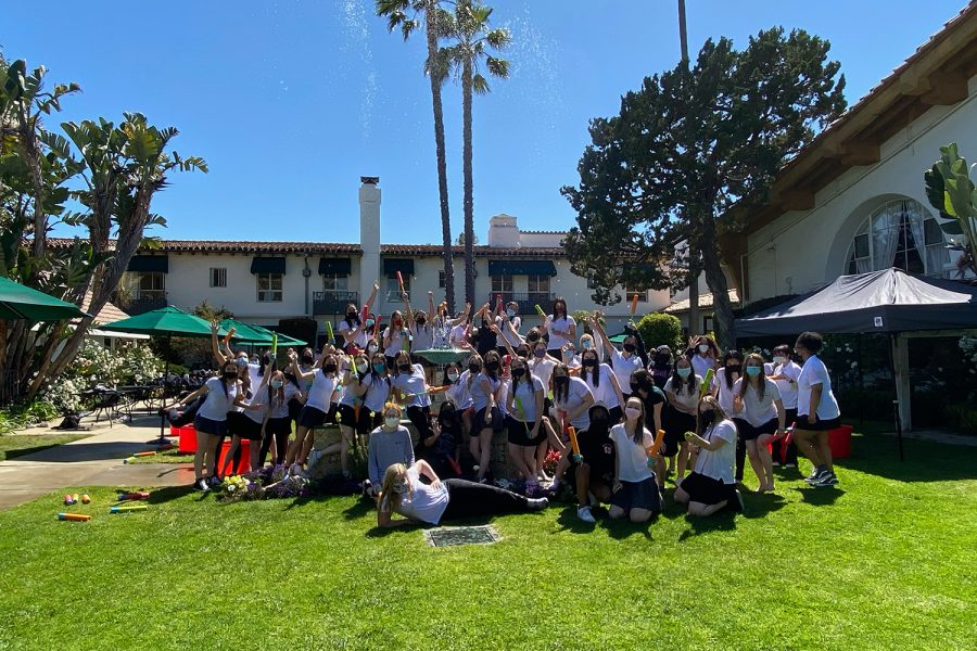 The Class of 2021 poses in front of the fountain in the Eastern Star courtyard after squirting one another with water for the adapted tradition, the fountain jump, on their last day of classes. After getting drenched in water, senior Ava Salomon described the event as the best kind of hectic.