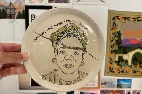 This is an art piece created by senior Gabby Wolf, which exemplifies the consequence of failure, an eternal moment of beauty. This piece depicts Maya Angelou, writer and activist, and reads, Nothing will work unless you do.