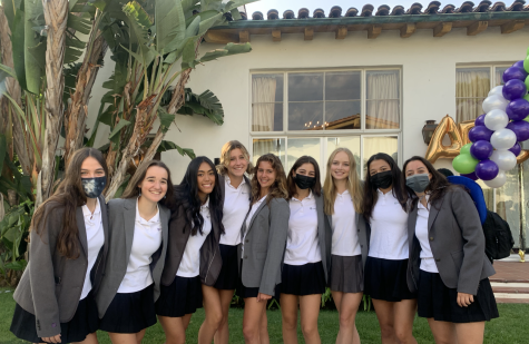 Seniors Mikayla Weinhouse, Isabella Specchierla, Faith Soriano, Thea Leimone, Gabby Wolf, Lily Miro, Lauren Robson, Ali Aragon and Marissa Gendy pose for a photo in the Eastern Star courtyard following upper school orientation. The students are dressed in the formal uniform blazers to mark the occasion.