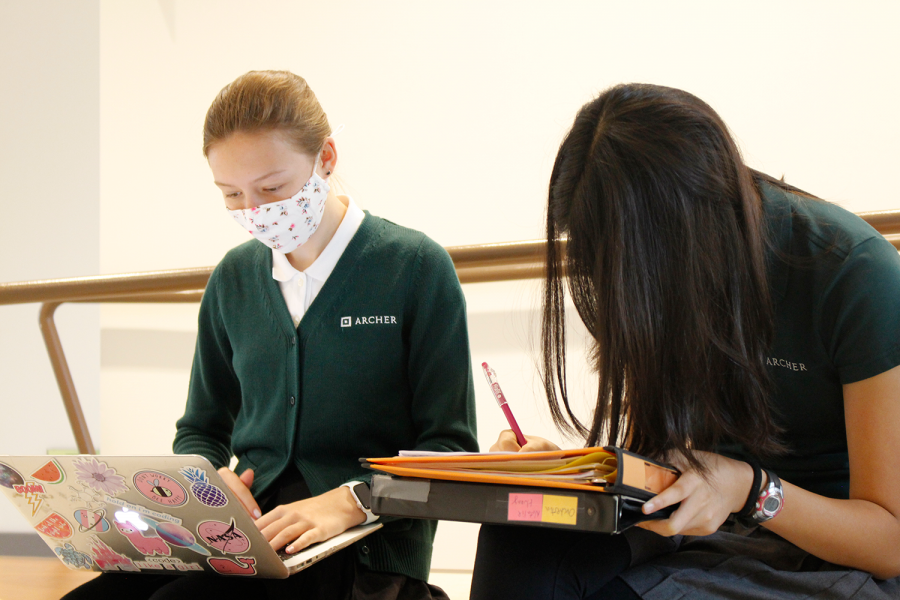 """Freshman Addie Myers and Natalie Huang study together in the student lounge during US-FLX block. Farley hopes students use this time to """"connect with each other,"""" which Myers and Huang said they appreciate following a long year of online learning."""