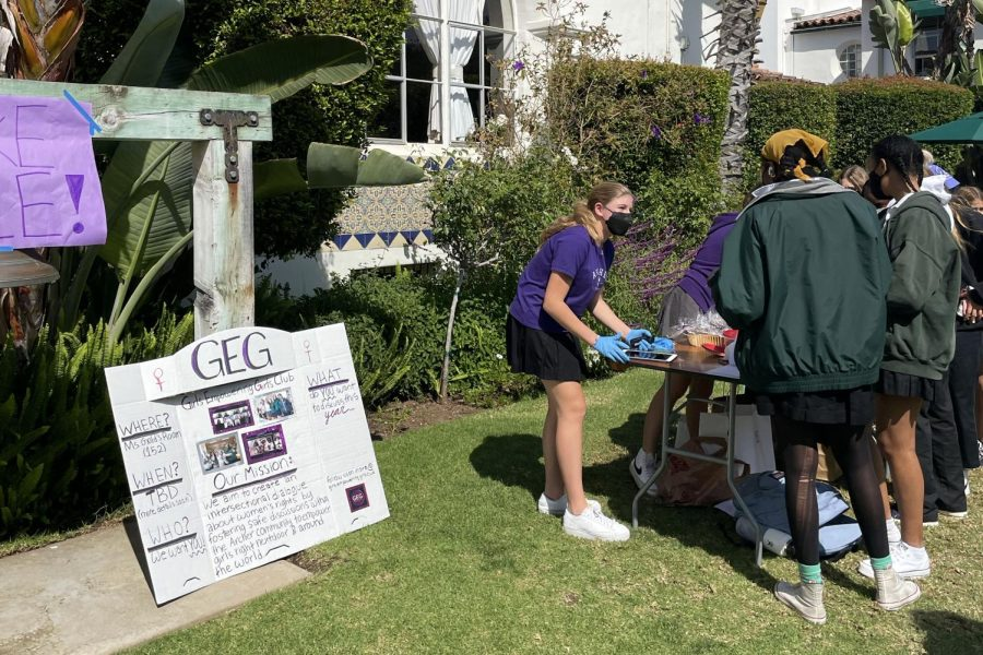 Freshman August Kohn sellsseniors Ruby Williams and Lexi Tooley baked goods for the GEG bake sale fundraiser in support of the LÍde foundation. The bake sale was one of multiple stations in the courtyard for the International Day of the Girl celebrationon Oct. 11.