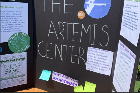 Student leaders ofThe Artemis Center set up a poster board during the club fair, informing the community on opportunities to engage with service. This year, as the club fair coincided with the Los Angeles climate strike, the Artemis center provided students with information about the strike happening that same day and encouraged students to sign a petition for California plastic laws.