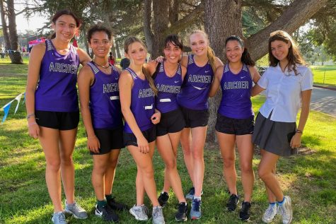 Members of the varsity cross country team celebrate after placing second in their first Liberty League meet of the season. They trained throughout the weeks prior to prepare for the meet. Pictured from left to right are Maya Acutt (25), Kayla Bruce (24), Kate Hanney (25), Gabriella Specchierla (25), captain Lauren Robson (22), Ali Aragon (22) and Keera Levell-Guerrero (23).