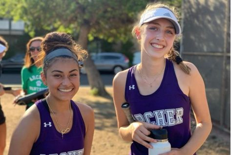 In this picture Senior Destiny Morado is posing with her match partner sophomore Alex Martin.  The amount of support we provide for each other, whether its onoroff the court, trying to help somebody academically,is incredible and heartwarming, Morado said.Were always going to be there to support each other and thats definitely something that I love most about our team.